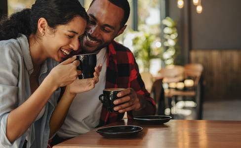 Affectionate couple having coffee on a date