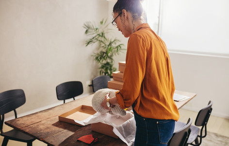 Seller packing products for online business