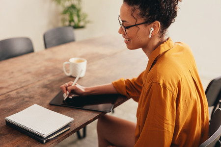 Businesswoman working from home using digital tablet