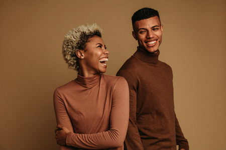 Fashionable african american couple on brown background