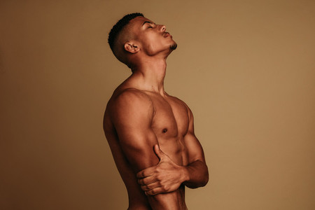 Side view portrait of muscular man