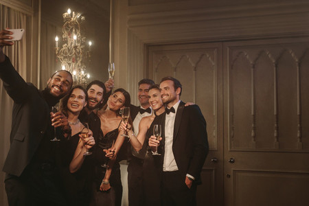Group of friends posing for a selfie at gala night