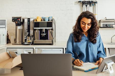 Female entrepreneur taking notes