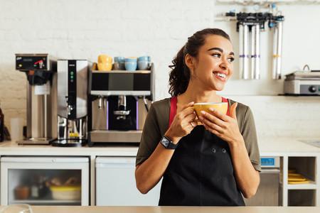 Female waitress holding coffee
