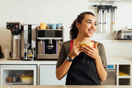 Female waitress holding coffee