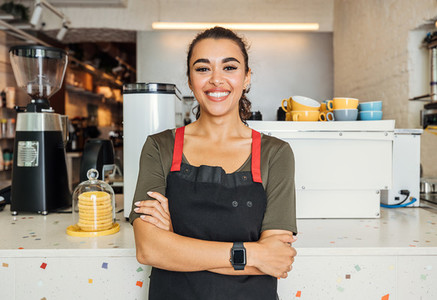 Female barista standing