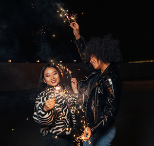 Two happy girls with sparklers