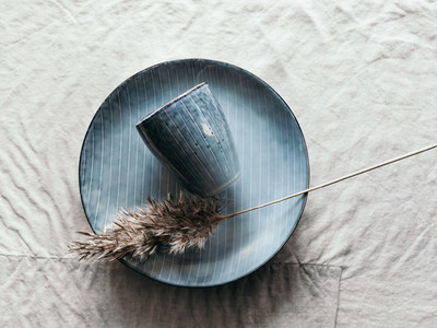 Set of a blue kitchen ceramic tableware oner linen cloth  Eco and minimal style home still life