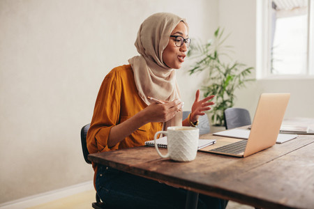 Muslim businesswoman on a zoom video call