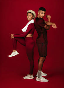 Portrait of fitness couple doing warm up exercises