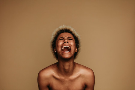 Portrait of african american woman shouting in pain