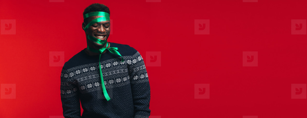 Man wrapped as a present