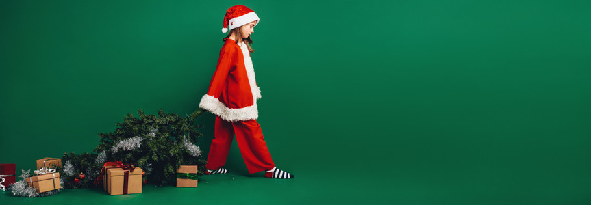 Little girl santa on green backgound