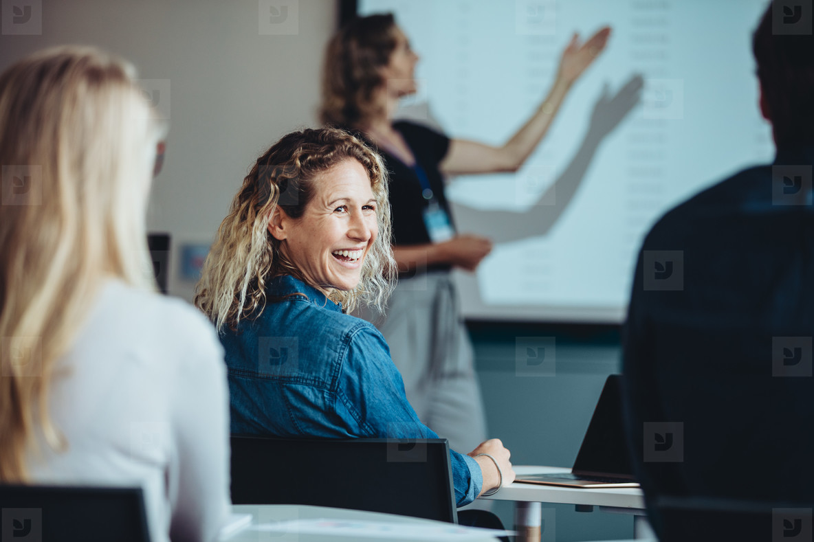 Businesswoman smiling during a presentation
