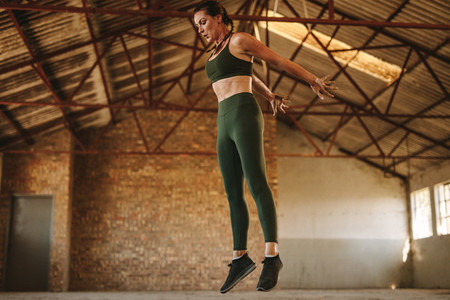 Sports woman doing jumping workout