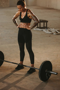 Fitness woman working out at old warehouse