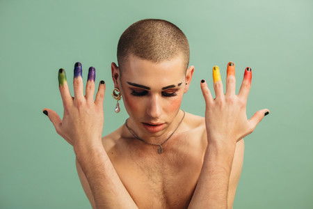 Gender fluid male with lgbt rainbow colored fingers