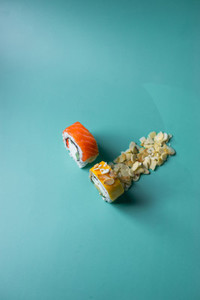 two sushi on light cyan background