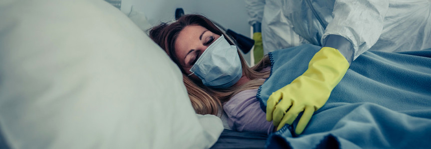 Woman in home quarantine for a virus attended by a doctor