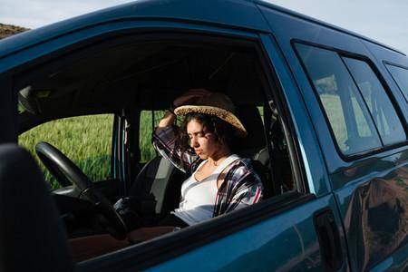 Farmer woman slipping in her van at crop field