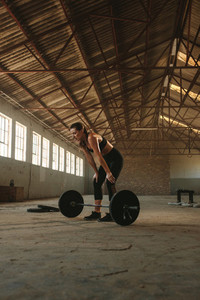 Woman taking rest after weightlifting training