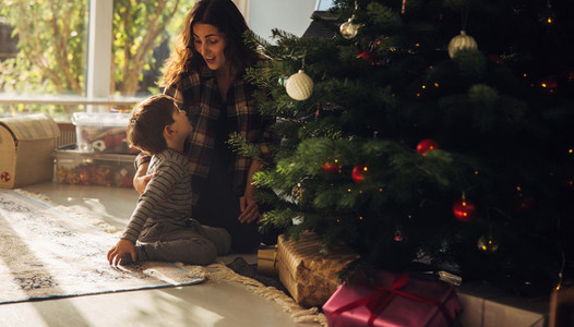 Mother and son at Christmas tree