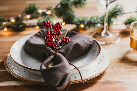 Festive table setting with winter decor  The concept of Thanksgiving or Christmas family dinner