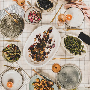 Flat lay of meat  salads  snacks and blooming mimosa  square crop
