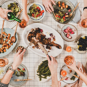 Flat lay of people eating and drinking rose wine square crop