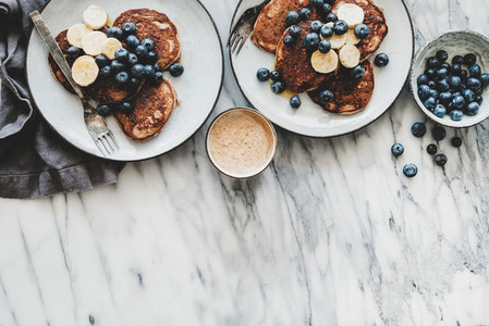 Breakfast banana pancakes with blueberry and coffee copy space