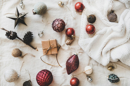 Flat lay of Christmas festive decoration toys over beige linen cloth