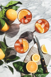 Aperol Spritz cocktail in glasses with oranges  top view