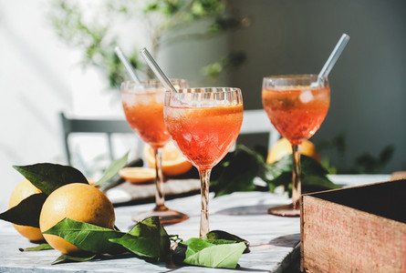Aperol Spritz cocktail in glasses with fresh oranges