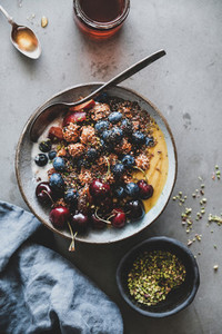 Healthy breakfast with quinoa granola coconut yogurt bowl on table