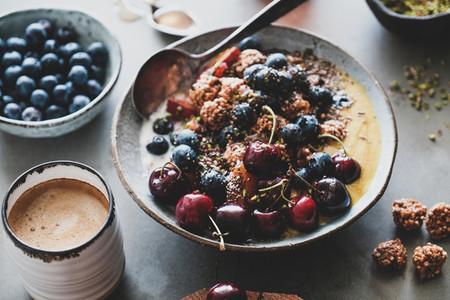 Healthy breakfast with quinoa granola coconut bowl and coffee