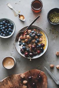 Healthy vegan breakfast with quinoa granola bowl and coffee