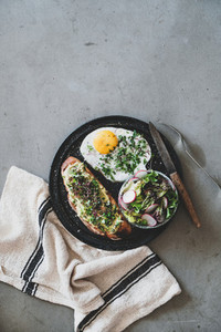 Healthy breakfast with avocado toast  fried egg and salad