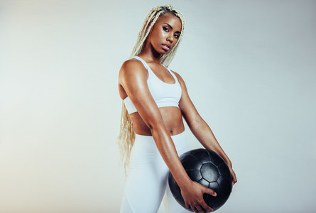 Close up of african american fit woman with a medicine ball