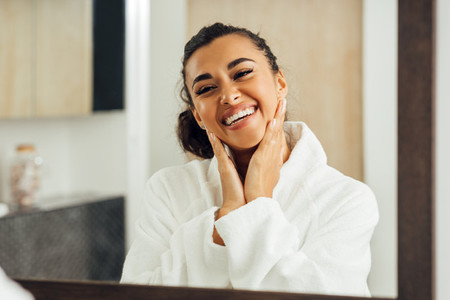 Happy woman in white bathrobe