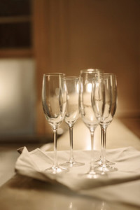 Empty champagne glasses on bar counter