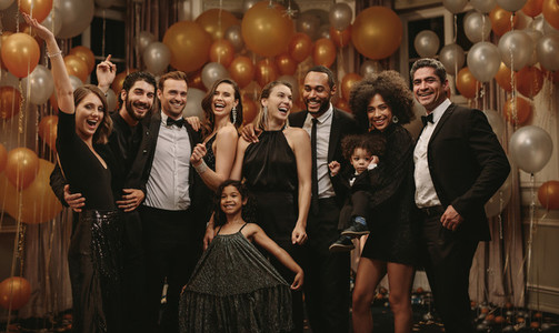 Group portrait of socialites on new years eve party