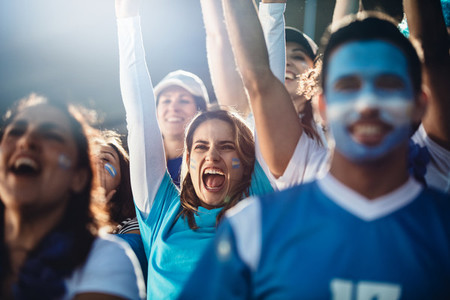 Argentinian soccer fans cheering in stadium