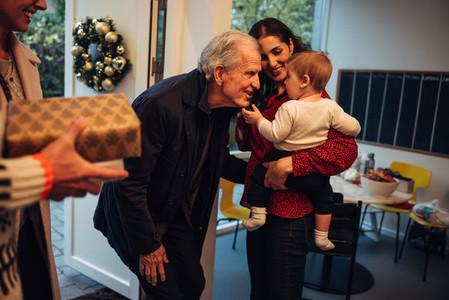 Senior couple visiting family for Christmas dinner