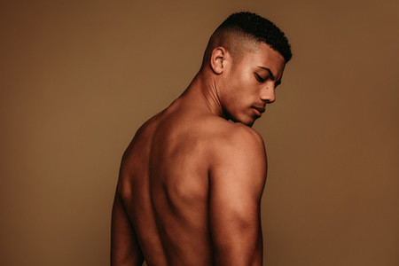 Rear view portrait of muscular african american man