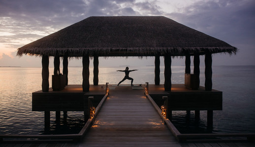 Yoga on a stilt house at a luxury beach resort