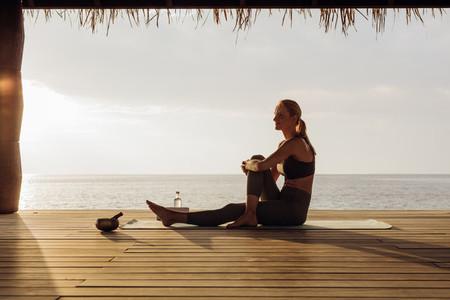 Yoga at a luxury beach stilt house