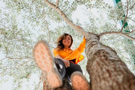 Woman enjoying climbing a tree  Freedom concept