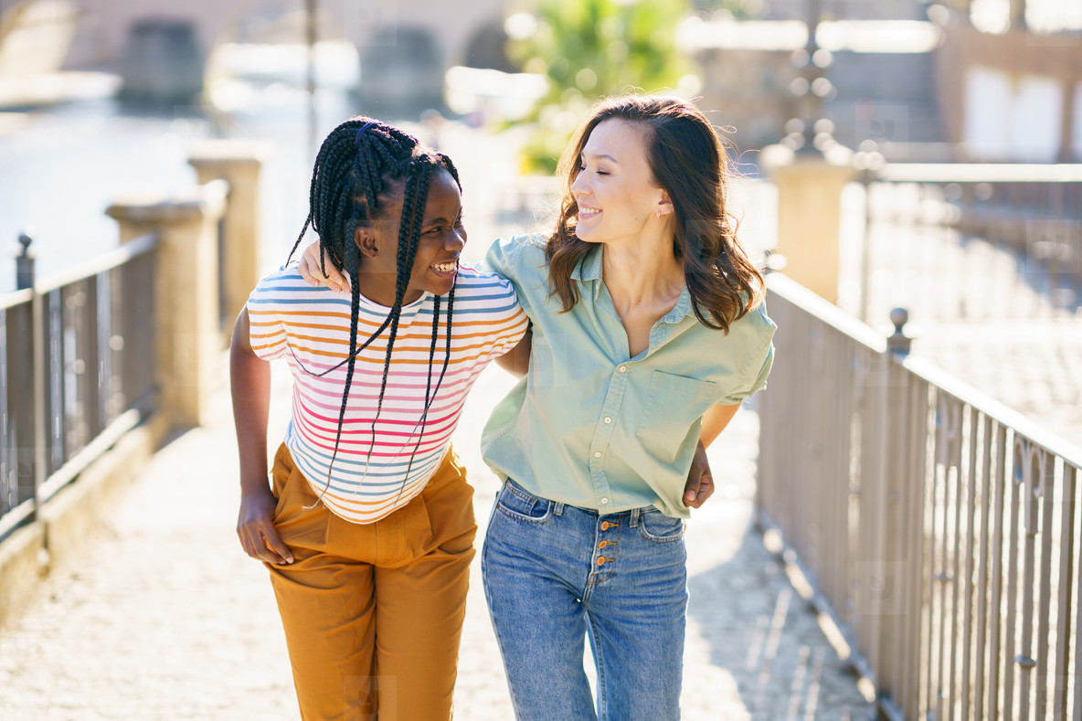 Two Multiethnic women walking together on the street