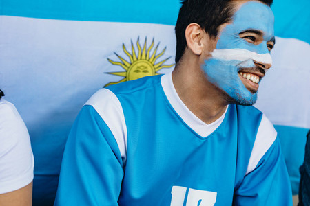 Devoted Argentina soccer fan in stadium