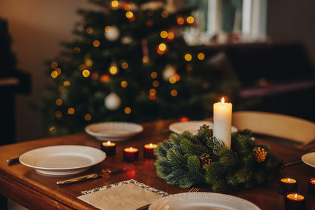Scandinavian home decorated for Christmas eve dinner